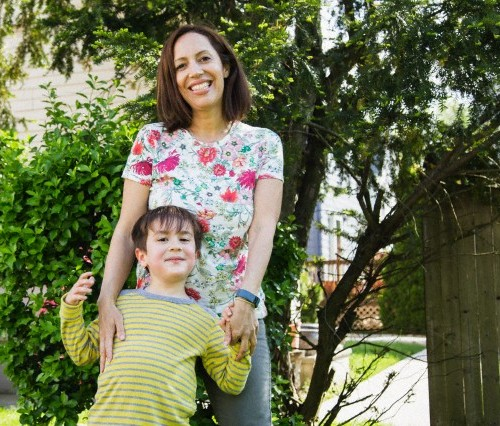 Portrait of mother with her son (6-7) in backyard